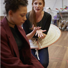 Rosalie Craig and Lois Chimimba in wonder.land rehearsals. Photo by Brinkhoff and Mogenburg