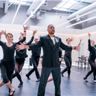 Cuba Gooding Jr. and the company in rehearsals for Chicago. Photo credit: Tristram Kenton.