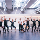 The company in rehearsals for Chicago. Photo credit: Tristram Kenton.