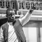 John Pfumojena in rehearsals for The Jungle. Photo credit: Marc Brenner