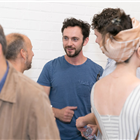 George Blagden in rehearsals for Company. Photo by Darren Bell