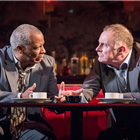 Don Warrington (George Aaronow) and Robert Glenister (Dave Moss) in Glengarry Glen Ross at The Playhouse, London. Credit: Marc Brenner